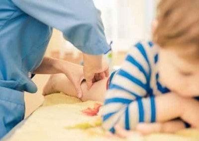 little boy getting leg massage on a provider table